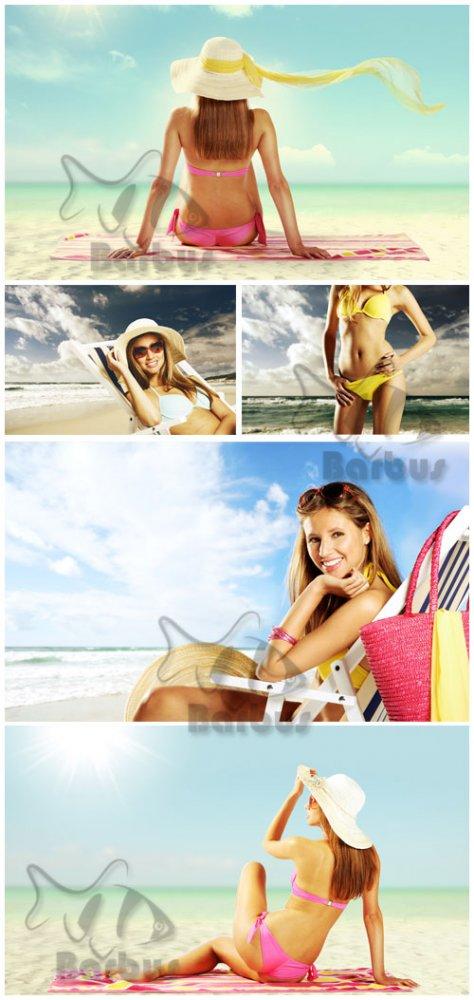 The girl on a solar beach / Девушка на солнечном пляже - Photo stock