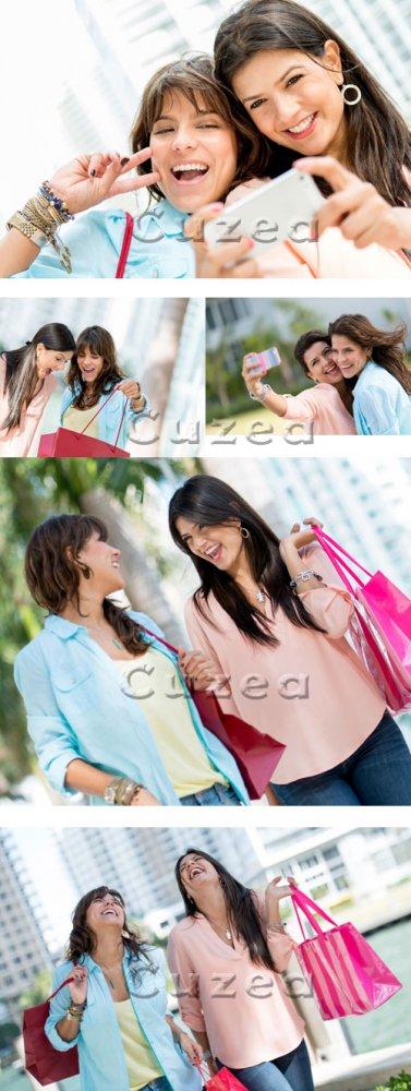 Девушки с покупками/ Girls with purchases - Stock photo