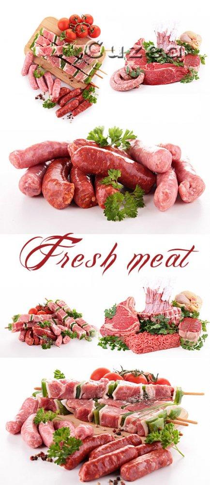 Свежее мясо на белом фоне/ Fresh meat  on white  background - Stock photo