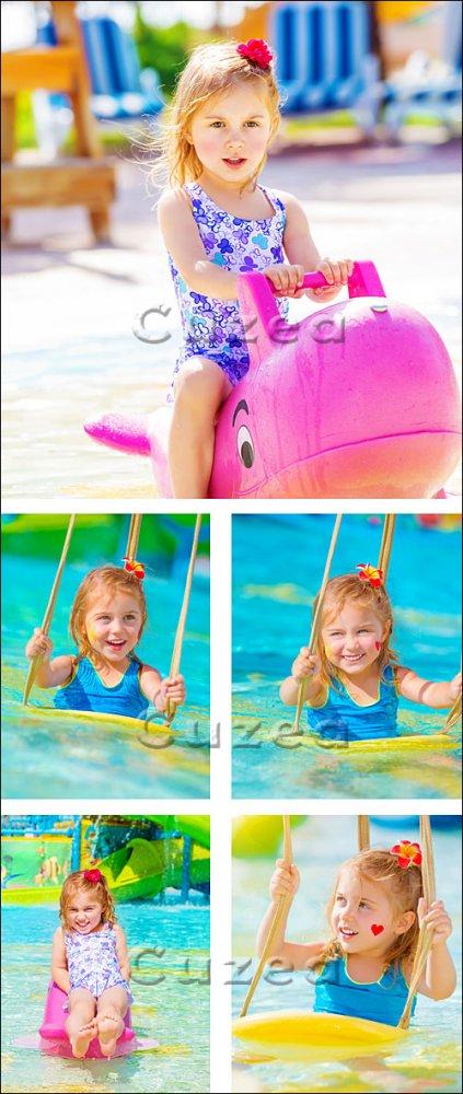 Счастливая девочка на воде/ Happy girl on water attractions - stock photo