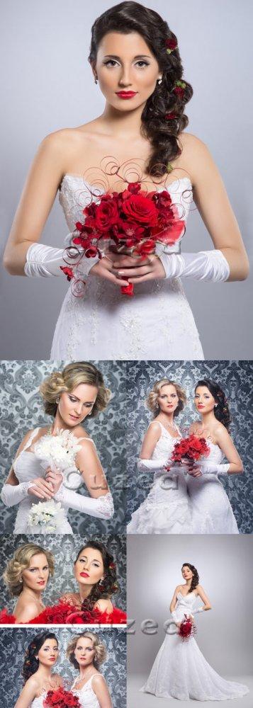 Невесты с красными розами/ Beautiful brides with red roses - Stock photo