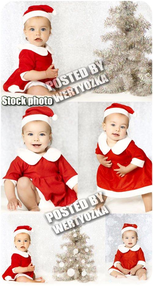 Маленькая девочка у новогодней елки / Little girl at a christmas tree - sto ...