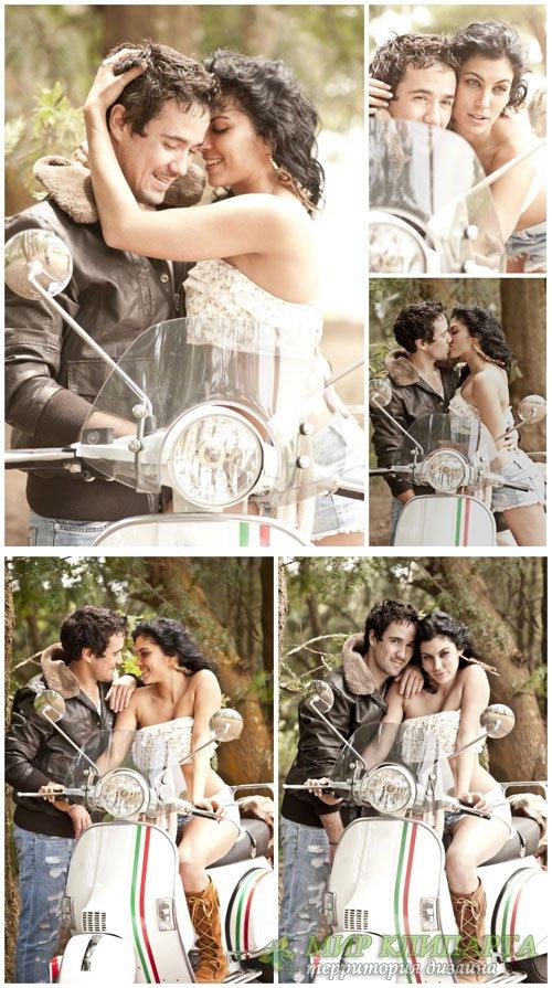 Влюбленная пара на мотоцикле / Loving couple on a motorcycle - Stock photo