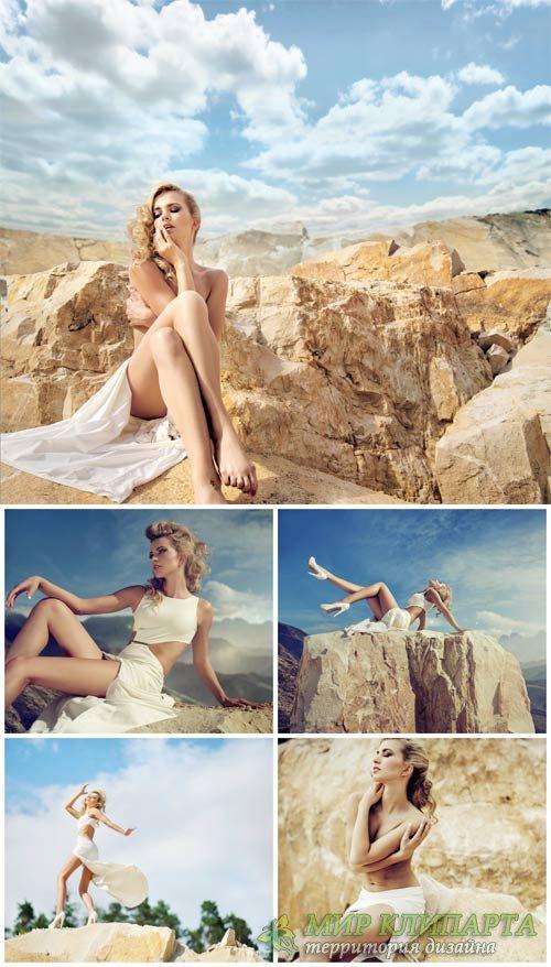 Светловолосая девушка на скале / Blonde girl on the rock - Stock Photo