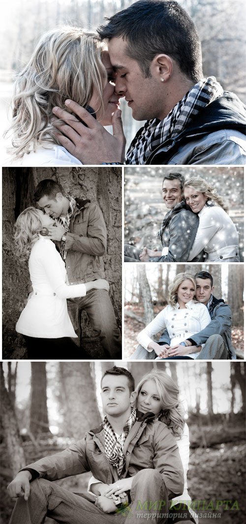 Loving couple in the winter forest - Stock Photo